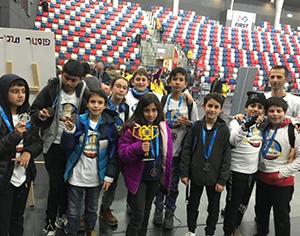 במקום הראשון בתחרות רובוטיקה אזורית: קבוצת הלגו של בית החינוך נבון